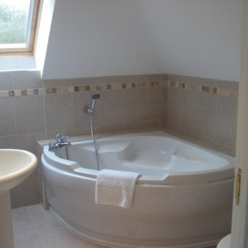 Family Bathroom with corner bath and shower