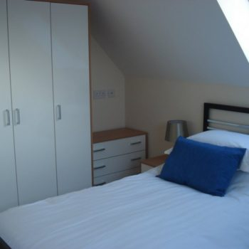 Twin room with wardrobe storage space
